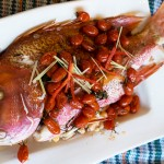 Baked whole Exmouth Red Emperor with prawns and lemongrass